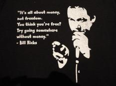 Bill Hicks - It's all about money, not freedom. You think you're free? Try going somewhere without money.